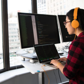 Woman-with-headphones-working-on-computer