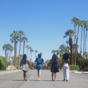 four-girls-walking-hand-in-hand-small
